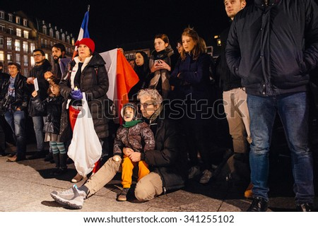 STRASBOURG, FRANCE - NOV 18, 2015: People gathering, placing flowers, messages and candles in center of Strasbourg, in solidarity for victims and families of the assault in Paris