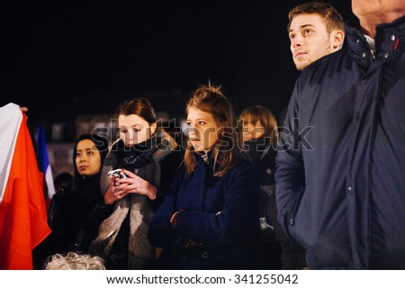 STRASBOURG, FRANCE - NOV 18, 2015: Sad people listening to speach in center of Strasbourg, in solidarity for victims and families of the assault in Paris