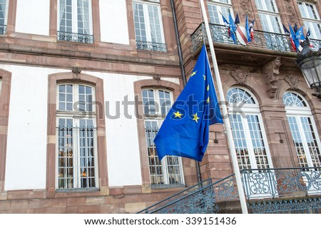 STRASBOURG, FRANCE - 14 Nov 2015: The European Union Flag flies at half-mast in front of the Strasbourg City Hall  following an terrorist attack in Paris - stock photo