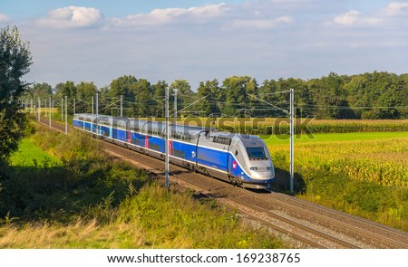 "STRASBOURG, FRANCE - SEPTEMBER 22: TGV train on a way from Strasbourg to Paris on September 22, 2013 in Strasbourg, France. The second phase of high-speed railway ""LGV Est"" will be opened in 2016"