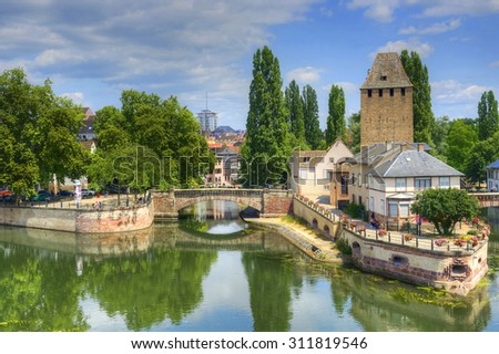 "Strasbourg, medieval bridge Ponts Couverts is located in the historic district ""Petite France"". Alsace, France. The historic center of Strasbourg is UNESCO World Heritage Site - stock photo"