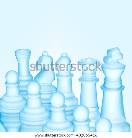 Strategy and tactics concept; icy frosted chess figures standing in a row ready for game - stock photo