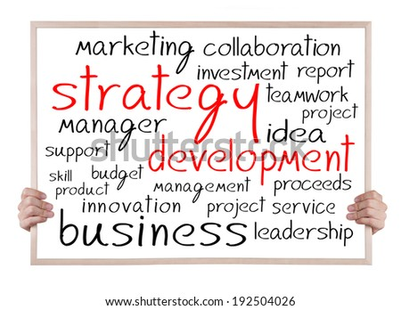 strategy development and other related words handwritten on whiteboard with hands
