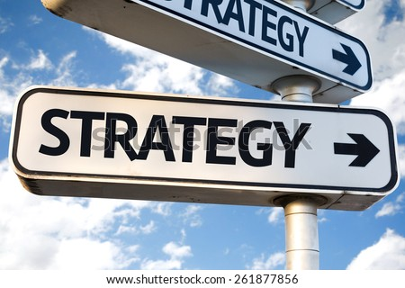 Strategy direction sign on sky background - stock photo