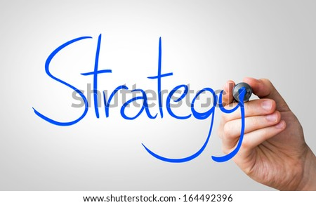 Strategy hand writing with a blue mark on a transparent board - stock photo