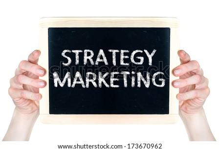 Strategy Marketing handwritten on blackboard which holding woman - stock photo