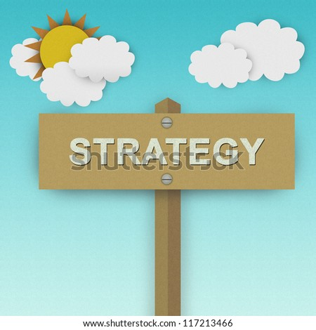 Strategy Road Sign For Business Solution Concept Made From Recycle Paper With Beautiful Sun and White Cloud in Blue Sky Background - stock photo