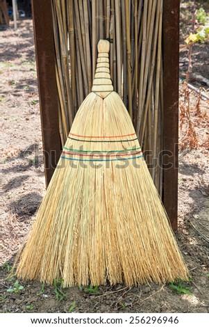 Straw broom - stock photo