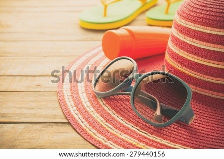 Straw hat and sunglasses on blue wood.Summer holiday background concept.Copy Space - stock photo