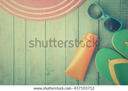 Straw hat and sunglasses on blue wood.Summer holiday background concept.Vintage Tone - stock photo
