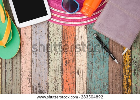 Straw hat and sunglasses on vintage wood.Summer holiday background concept.Copy space - stock photo