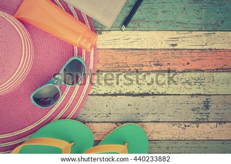 Straw hat and sunglasses on vintage wood.Summer holiday background concept.Copy space.Vintage Tone - stock photo