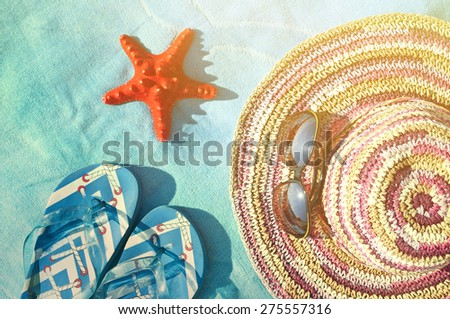 Straw hat, glasses, sea star and flip-flop sandals - Vacation concept  - stock photo