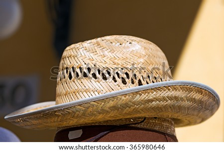 Straw Hat in a Shop / Detail of a straw hat in a shop in the summer
