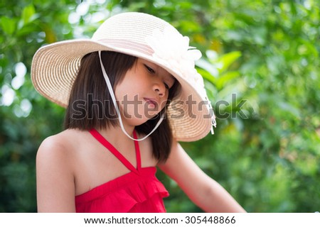 straw hat, kid, girl, pretty, childhood, asian, happy, asian, little,beautiful, portrait, red, thoughtful, musing, pensive, dress, calm, quiet, cute, daydream, reverie, young,contemplative,reflective, - stock photo