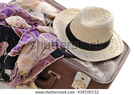 straw hat on a suitcase with sarong isolated on white background  - stock photo