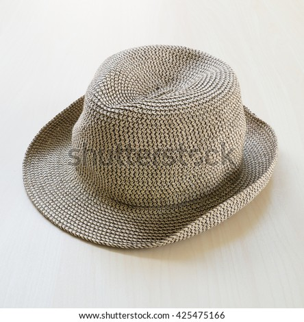 straw hat on wooden background