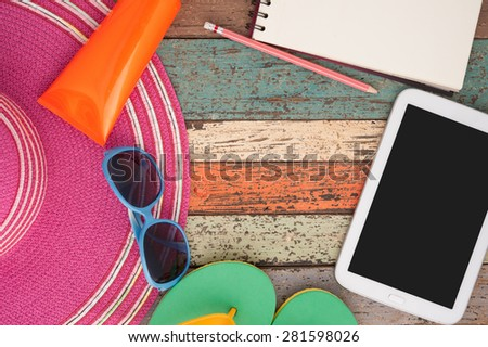 Straw hat tablet and sunglasses on vintage wood.Summer holiday background concept.Copy space - stock photo