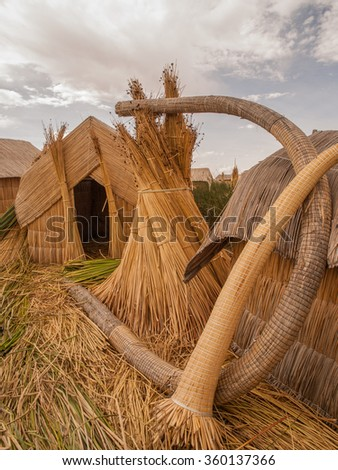 Straw huts on floating island, Lake Titicaca, Peru.