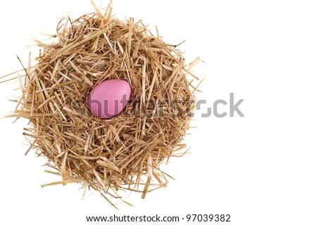 Straw nest with nice colored Easter eggs over white studio shoot