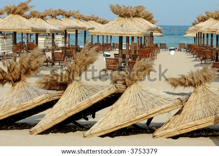 straw sheds at beach - stock photo