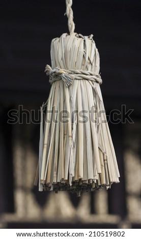 Straw tassel detail from Shinto shrine - stock photo
