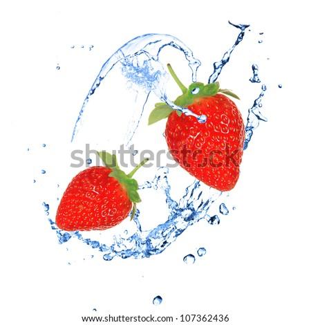 Strawberies with water splash over white - stock photo