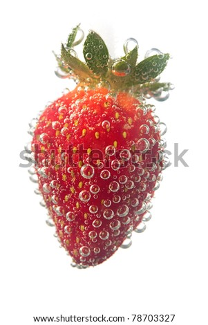 strawberrie in water bubble over white background - stock photo