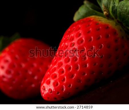 Strawberries against a black background