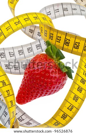 strawberries and a tape measure for successful diet. on a white background - stock photo