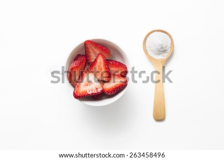 Strawberries and baking soda in wooden spoon for tooth whitening - stock photo