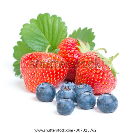 Strawberries and blueberries on white background - stock photo
