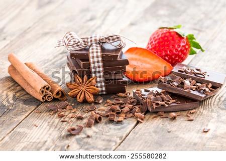 Strawberries and chocolate brown wooden table. - stock photo