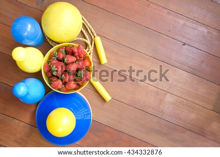 strawberries and sports equipment for children's training - backgrounds