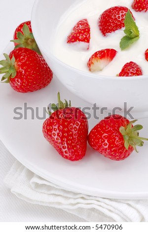Strawberries and yogurt with a sprig of mint.