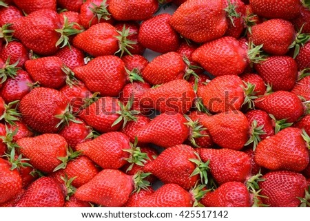 Strawberries. Background from fresh strawberries, Red strawberries.  Strawberries at market.   Strawberries fruits. Healthy strawberries.  - stock photo