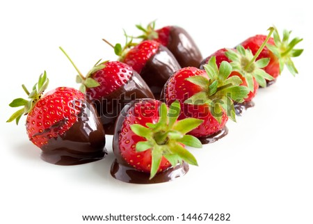Strawberries dipped in delicious chocolate isolated on the white background - stock photo