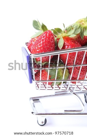 Strawberries in a shopping cart isolated