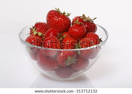 Strawberries in a transparent glass bowl