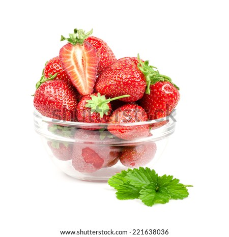 Strawberries in a transparent plate. Strawberry leaves. The mate. Isolated. - stock photo