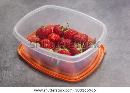 Strawberries in a tupperware - stock photo