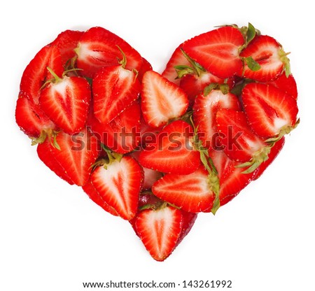 Strawberries in heart shape - stock photo