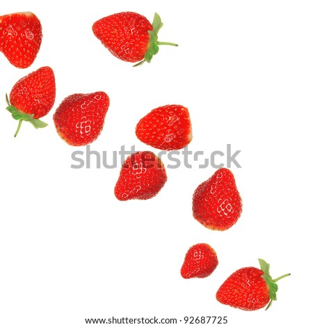 Strawberries in milk splash over white background - stock photo