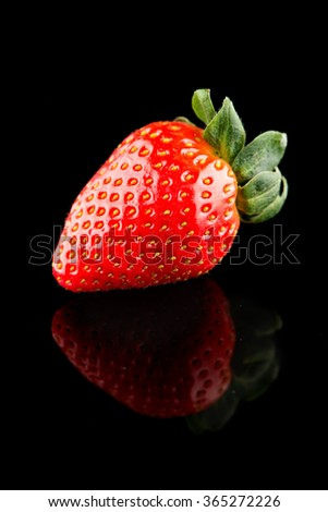 strawberries isolated on black background - stock photo