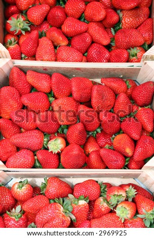 strawberries on wooden box in the fruitshop