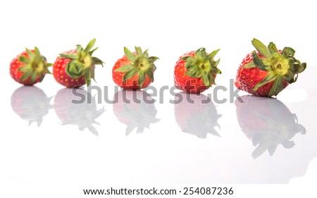 Strawberries over white background - stock photo