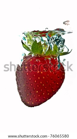 strawberries plunging into the water - stock photo