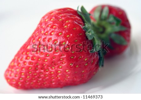 Strawberries shot on white background - stock photo