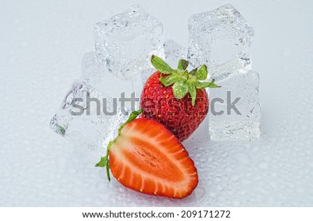 Strawberries with ice cubes