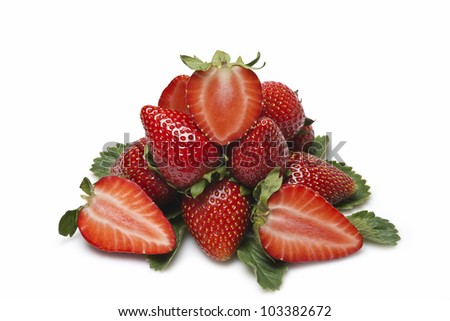 Strawberries with their leaves isolated on a white background